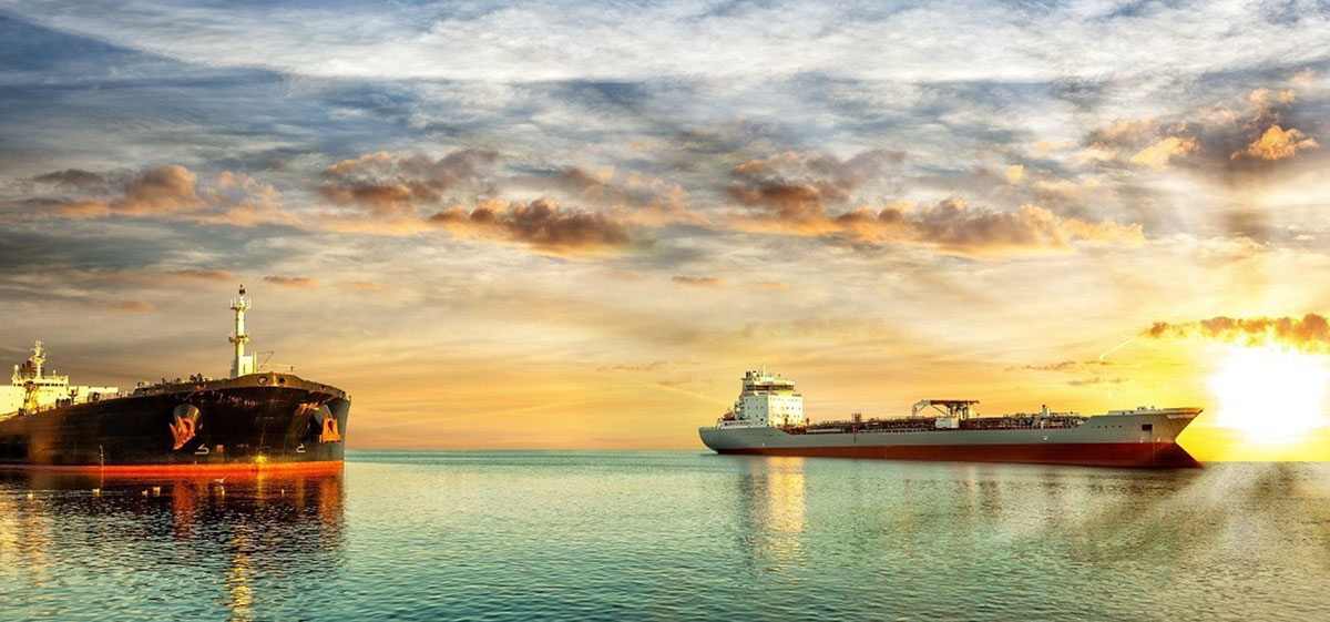 Two vessel at sea in sunset