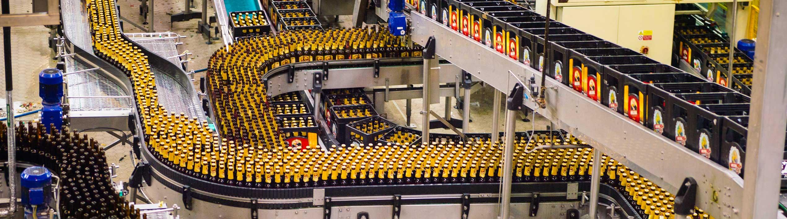 Conveyor with yellow bottles