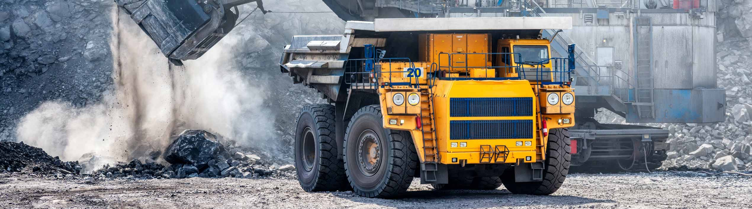 Big yellow dumper in mining field